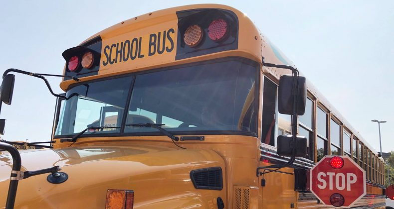 school bus with stop arm out