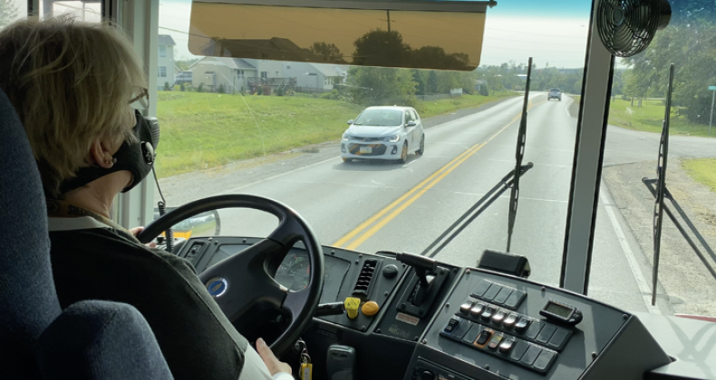 School bus driver driving a bus route.