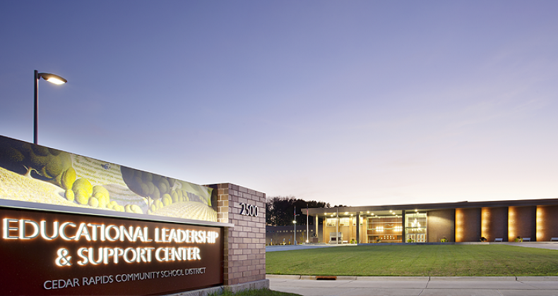 Educational Leadership and Support Center building at dusk
