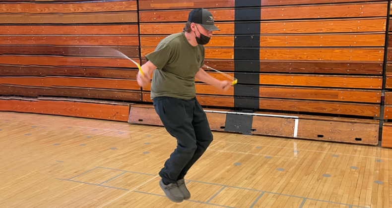 A student jumping rope in PE class.