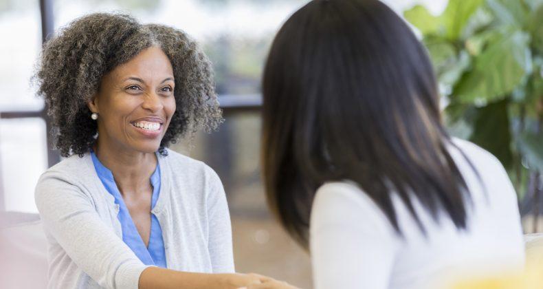 teacher greets female parent