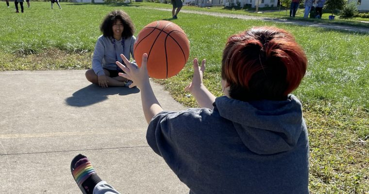 Students passing a basketball