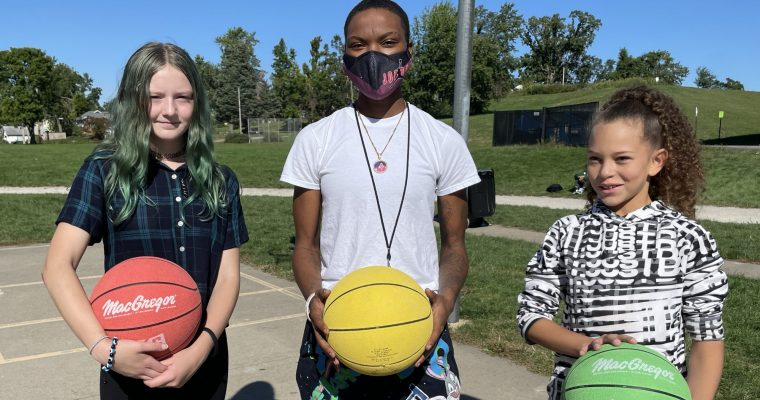 Students holding a basketball