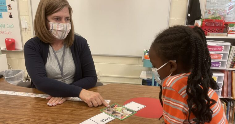 Teacher working with Ell student