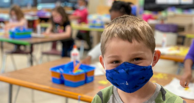 Student with a mask in a Grant Classroom