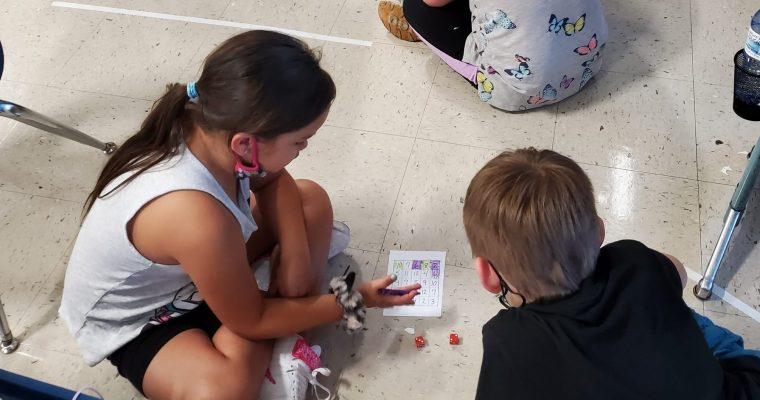 Students playing a math game with partners