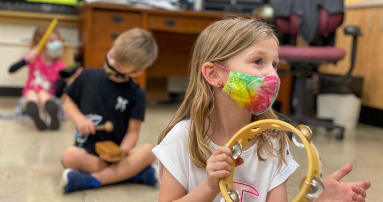 Music Class girl playing tambourine