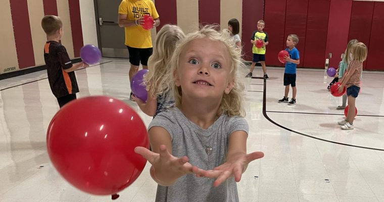 STUDENT TRYING TO CATCH A BALLOON