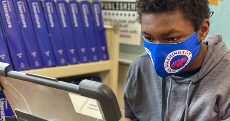 A Washington student works on his laptop.