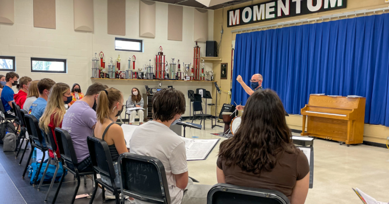 Students in music sing during class.