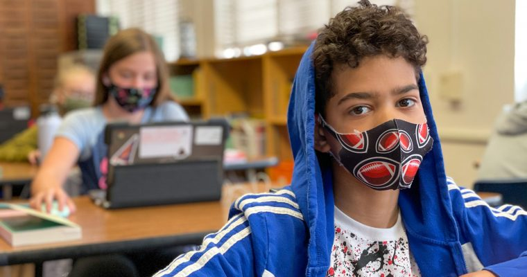 students in classroom wearing masks