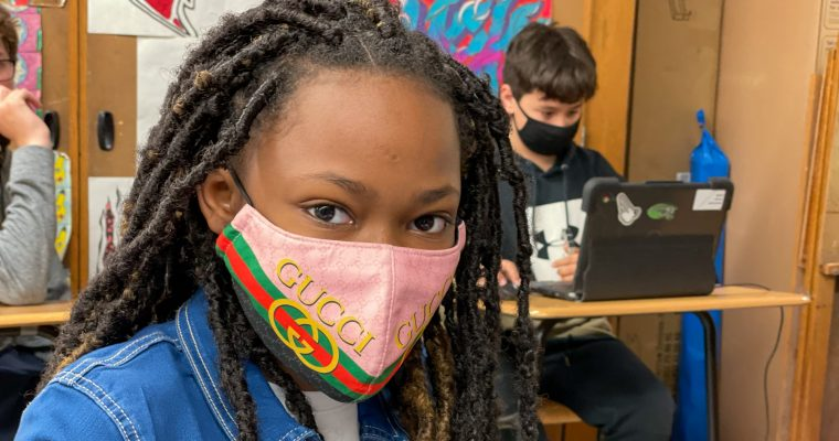 student smiling wearing a mask