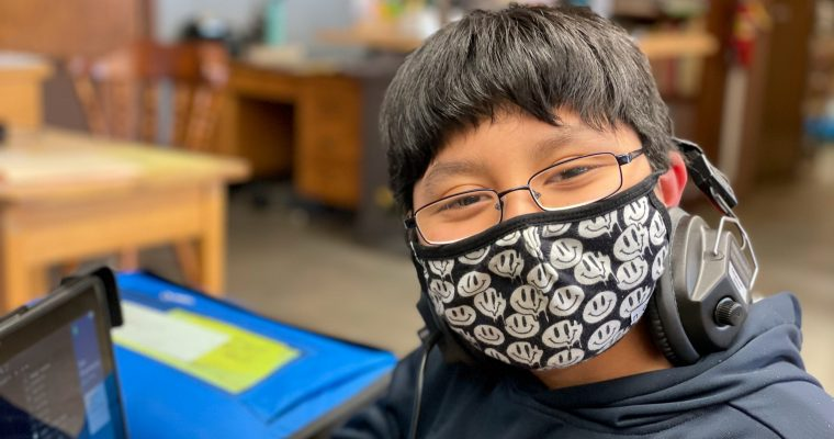 Student smiling with mask