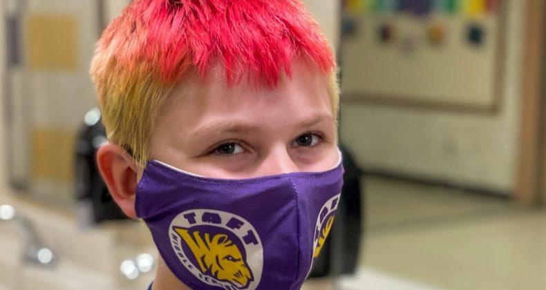 Student with Taft mask