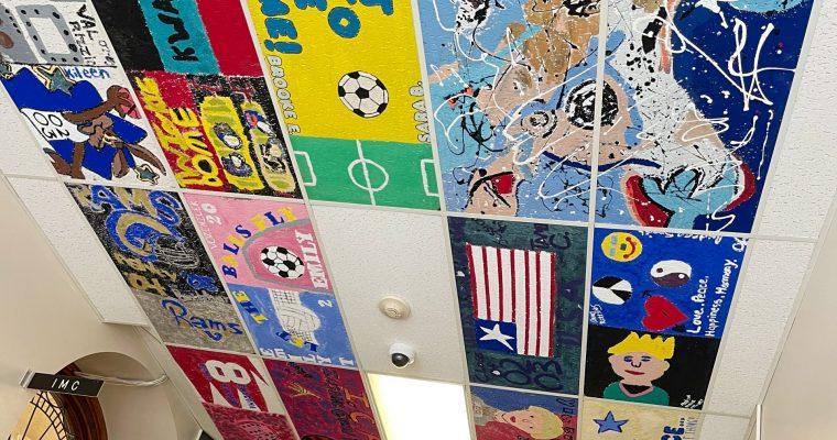 Painted ceiling tiles in hallway